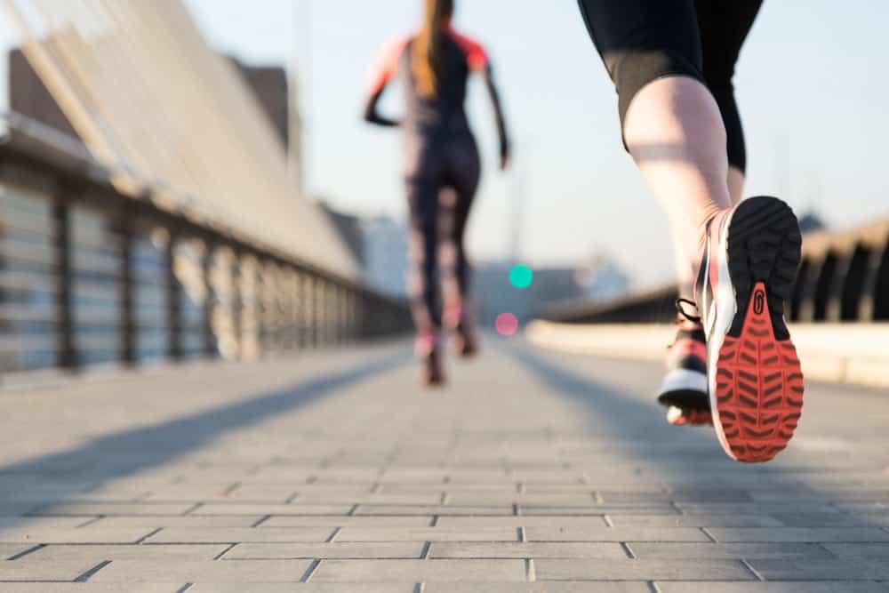 close up woman running with unfocused background 101 Aneka Slogan Terkini untuk Pendidikan, Motivasi, Kesehatan dan Agama